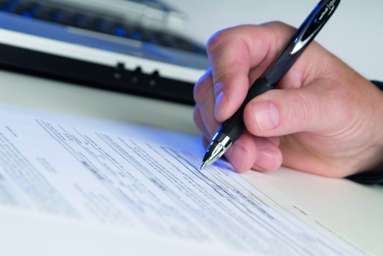 A person signing a form