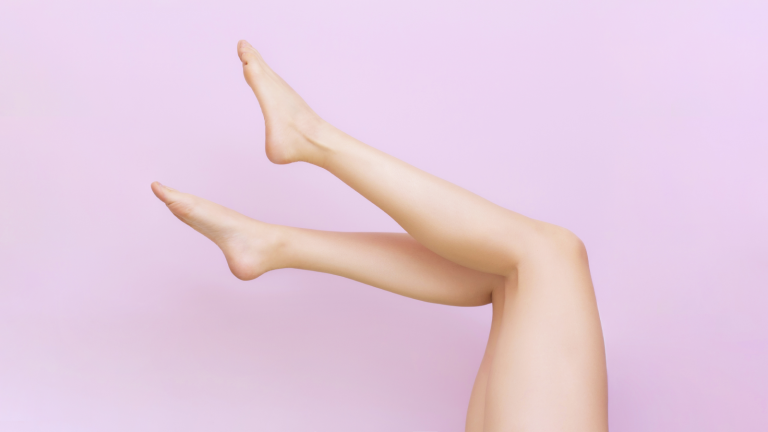 Hair free legs against a pink backdrop