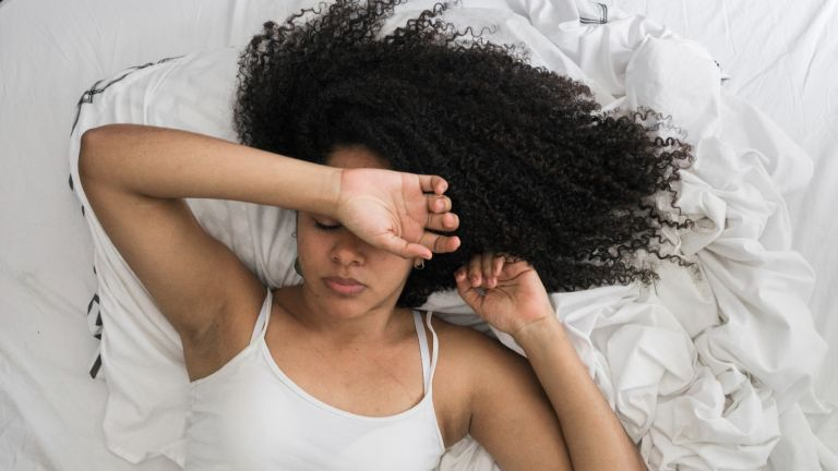 Woman in the bed - stock photo
