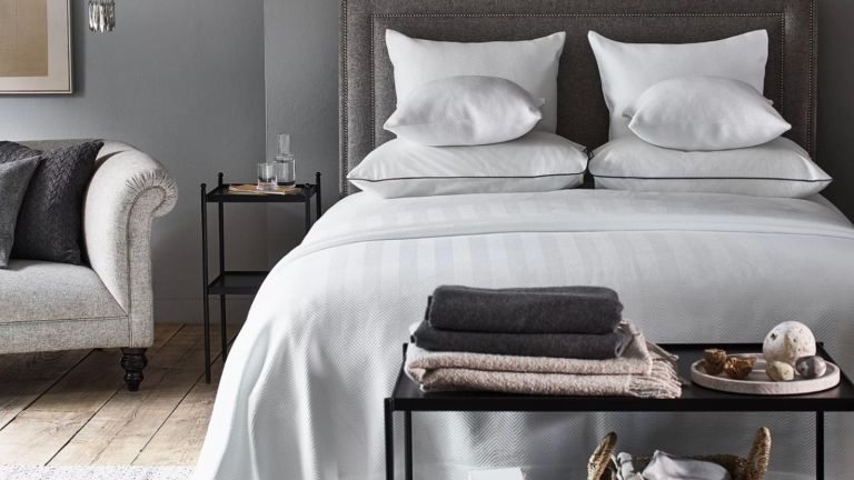 Abingdon Duvet Cover in grey bedroom on bed with black metal bedside table and black metal table at the end of bed
