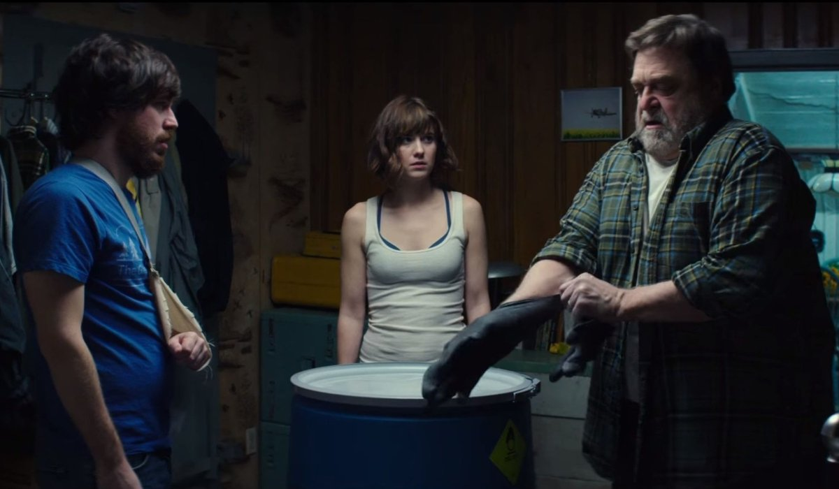 10 Cloverfield Lane the bunker survivors circle around a container