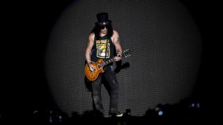 A photograph of Guns N' Roses guitarist Slash onvstage