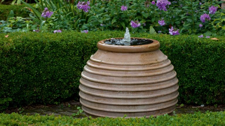 how to keep a water feature clean: terracotta water feature