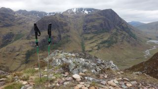 trekking poles and a mountain