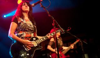 Girlschool's Kim McAuliffe performs on stage at the Relentless Garage on March 10, 2012 in London