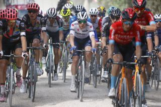 Team Deceuninck-QuickStep rider Belgiums Remco Evenepoel rides in the pack during the eleventh stage of the Giro dItalia 2021 cycling race 162 km between Perugia and Montalcino on May 19 2021 Photo by Luca Bettini AFP Photo by LUCA BETTINIAFP via Getty Images