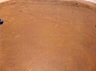 """NASA's Ingenuity Mars Helicopter took this photo during its fourth flight on April 30, 2021. The image shows """"Airfield B,"""" where Ingenuity will seek to land on its fifth flight, on May 7."""
