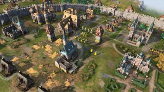 Age of Empires IV town with various buildings and units on display