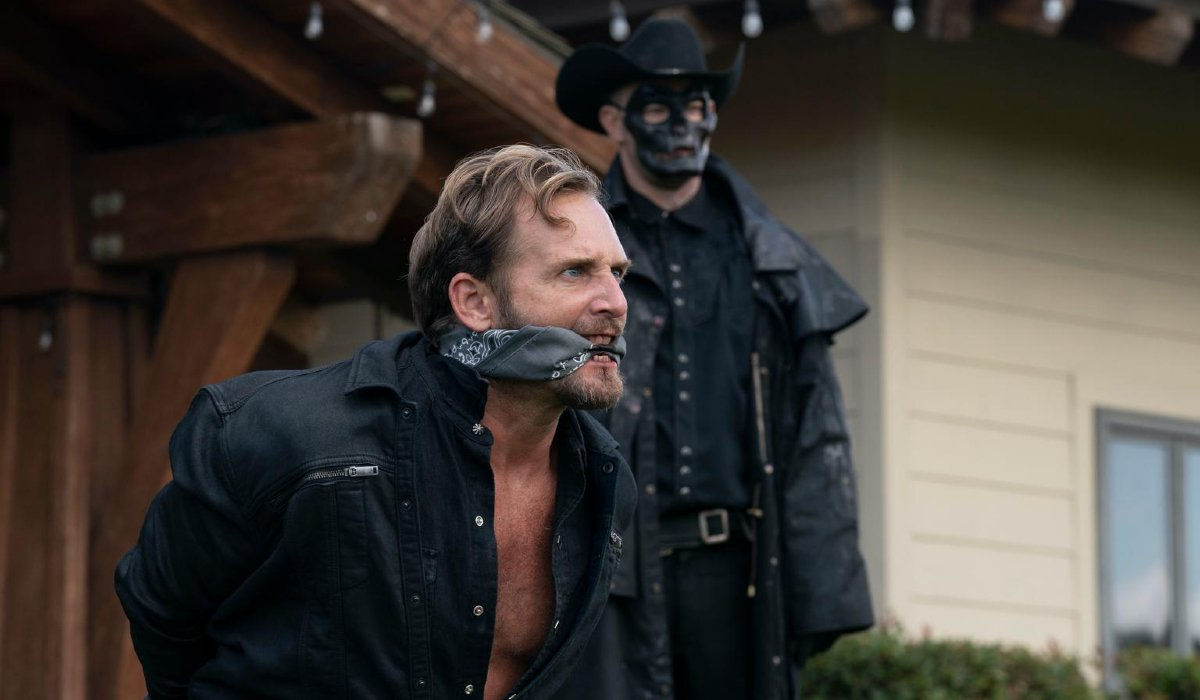 Josh Lucas gagged and tied by a purger in The Forever Purge.