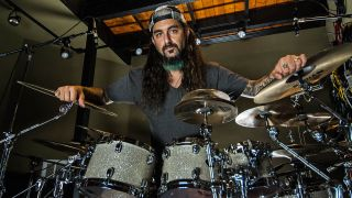 A portrait of mike portnoy at his drums