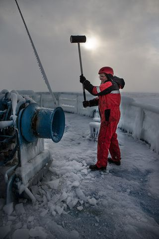 Breaking ice off icebreaker vessel, Svalbard expedition