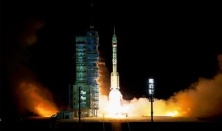 A Chinese Long March 2F rocket launches the three Shenzhou 13 astronauts on a six-month mission to the country's new Tiangong space station module Tianhe from theJiuquan Satellite Launch Center in the Gobi Desert on Oct. 16, 2021 local time (Oct. 15 EDT).