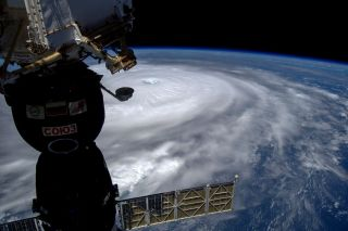 Russian cosmonaut Sergey Ryazanskiy took this photo of Hurricane Irma from orbit on Sept. 7, 2017 while he flew overhead aboard the International Space Station. A Soyuz crew capsule is visible at left.