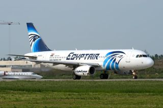 gyptair AIrbus A320 SU-GCC slowing down on runway at Domodedovo International airport in 2011.