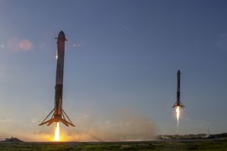 Two SpaceX Falcon Heavy first-stage boosters ace their landings shortly after helping launch the Arabsat-6A satellite on April 11, 2019.