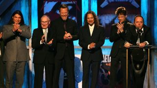 Robert Trujillo, Ray Burton, James Hetfield, Kirk Hammett, Jason Newsted and Lars Ulrich at Metallica's 2009 Rock And Roll Hall Of Fame induction ceremony