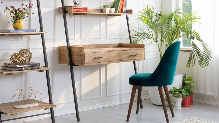 a neat wood and steel ladder desk design with velvet green chair in a living room by Wayfair