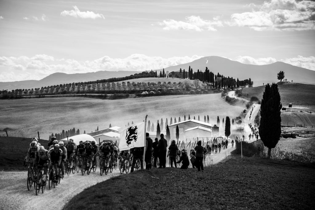 The pack rides through a gravel road during the oneday classic cycling race Strade Bianche White Roads on March 9 2019 around Siena Tuscany Photo by MARCO BERTORELLO AFP Photo credit should read MARCO BERTORELLOAFP via Getty Images