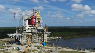 The core stage of the Artemis 1 SLS rocket as seen on the test stand at NASA's Stennis Space Center in Mississippi.