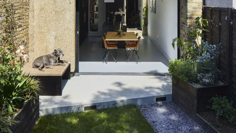 Small patio leading from kitchen with bifold doors