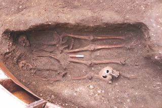 The skeletons of two men were found buried in a double grave in London, their fingers entwined.
