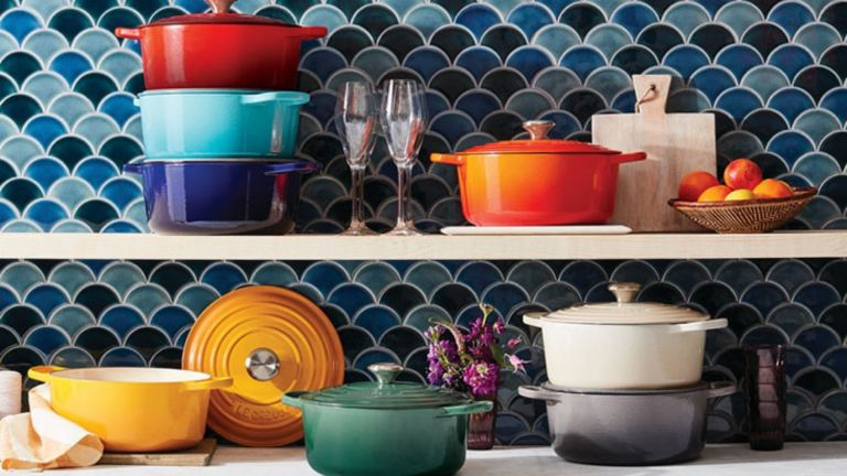 Le Creuset sale: cookware in kitchen on blue tiled wall