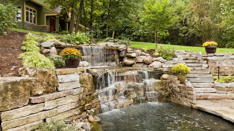 backyard pond ideas with waterfall and stone steps