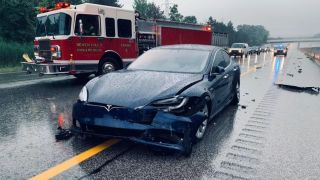 Tesla model 3 that got into an accident on the highway. -- Cropped