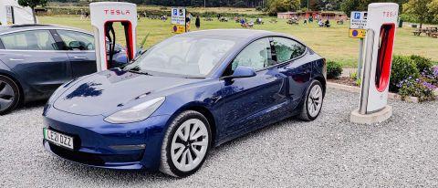 Tesla Model 3 parked in charging station
