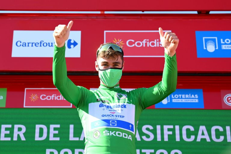 Fabio Jakobsen on the podium in his green jersey after winning the fourth stage of the 2021 Vuelta