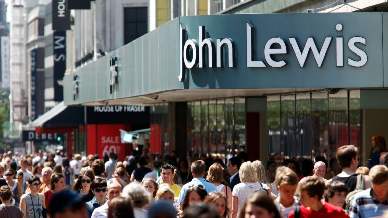 John Lewis home insurance ad— Shoppers walk past a John Lewis store on Oxford Street in London, U.K., on Tuesday, June 30, 2009. The number of Britons making shopping trips fell for a fifth consecutive month in June, deterred by warmer weather and the bleak economy. (Photo by Jason Alden/Bloomberg via Getty Images)