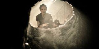 Annihilation Natalie Portman looking down a mysterious hole