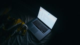 Laptop in the dark with Gmail open