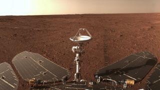 China's Zhurong Mars rover captured this panorama of the Red Planet. Visible in the foreground are the rover's solar panels and communications equipment.