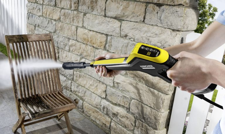 Kärcher K5 power control pressure washer being used on a chair
