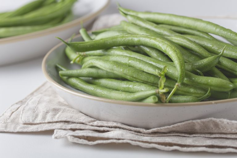 freshly cooked French beans on a plate