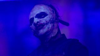 A photograph of Slipknot singer Corey Taylor on stage