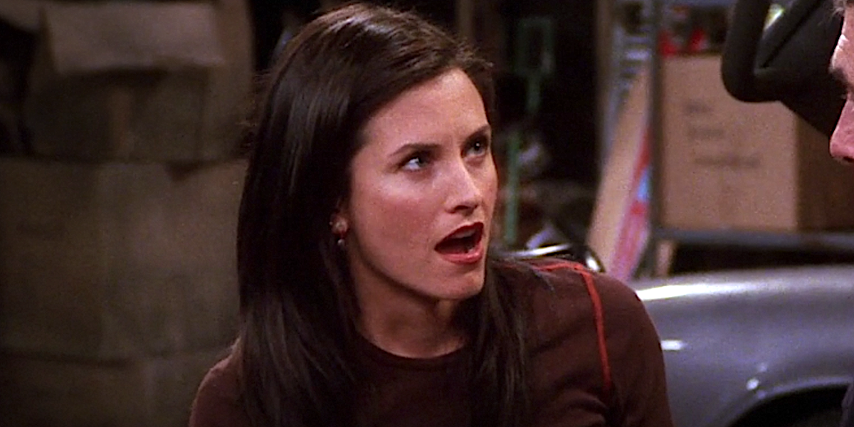 Friends Monica Courtney Cox reacts as Ross says something at their parents' house.