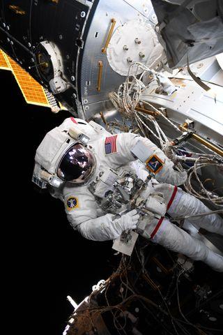 NASA's Artemis Moon Program Just Photobombed a Spacewalk (Photo)