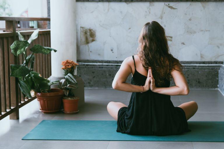 woman posing on blue yoga mat