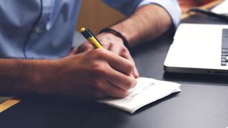 Man writing on a pad