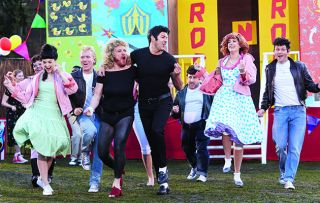 Keith Lemon and Paddy McGuinness dress up as Sandy and Danny to recreate the iconic show Grease in just half and hour