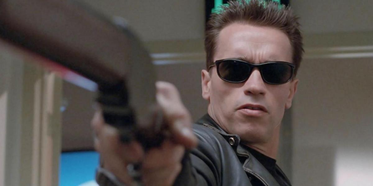 Arnold Schwarzenegger as Terminator in sunglasses, pointing gun