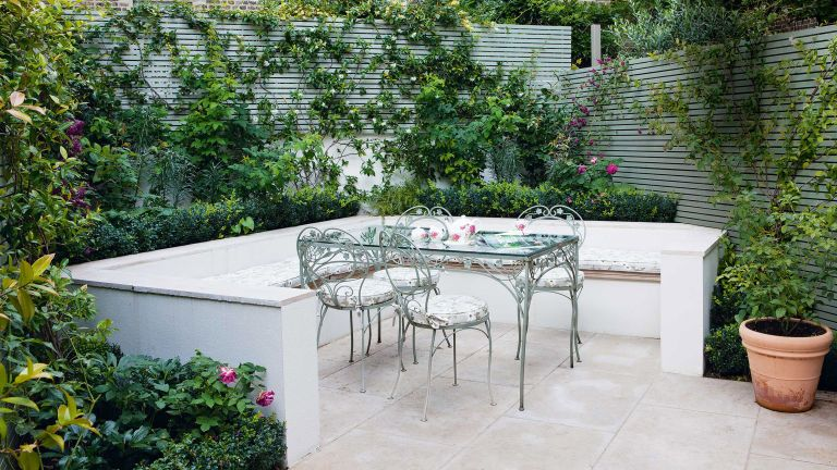 garden privacy ideas: green fence panels around seating area