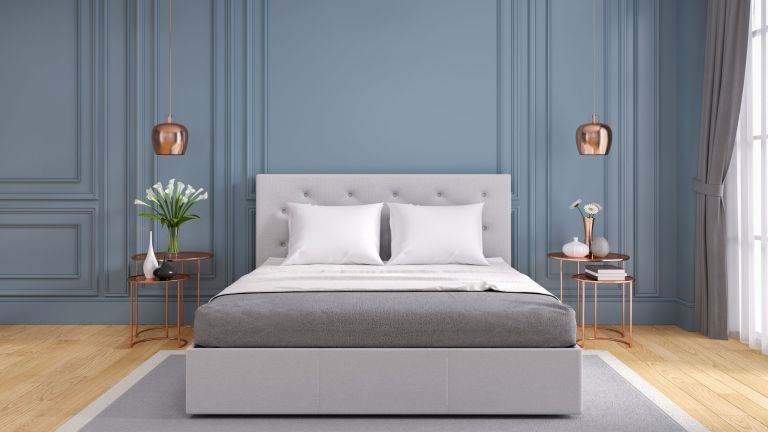 Grey stylish bedroom with bed and pillows