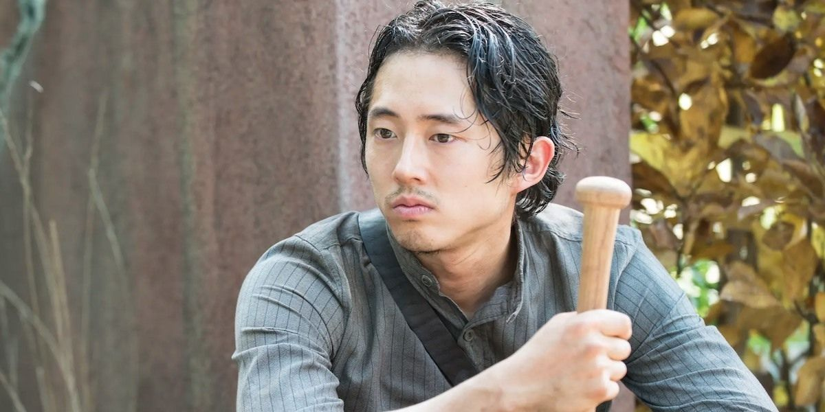 Steven Yeun holding a bat in The Walking Dead