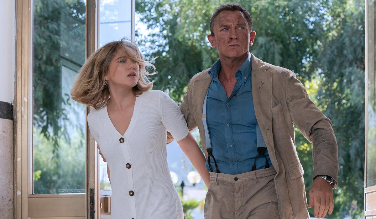 A bloodied Daniel Craig escorts Lea Seydoux to safety in No Time To Die.