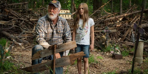 Pet Sematary Jud and Ellie standing in the middle of the burial ground