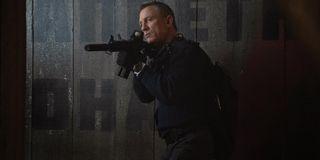 No Time To Die Daniel Craig in tactical gear, taking aim