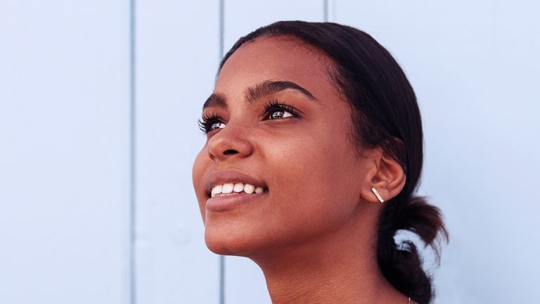 smiling young woman with groomed brows